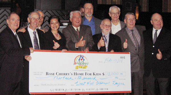 Cheque for $13,000 presented to Rose Cherry's Home for Kids from The West Mall Oldtimers